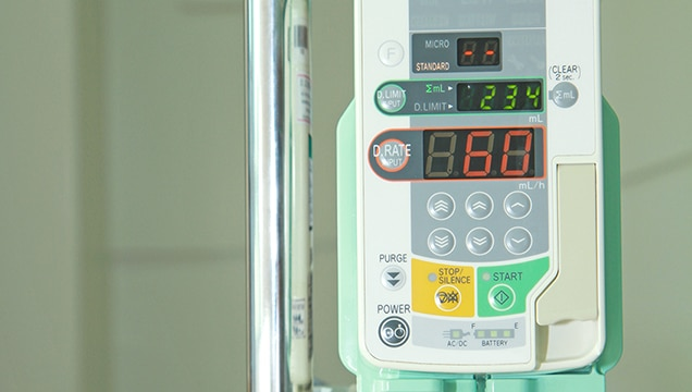 Medical infusion machine located on stand in hospital room